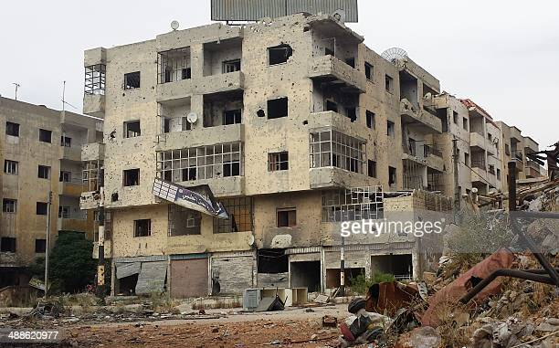 A general view of bullet and rocket riddled buildings in the Jab alJandali district of the central city of Homs on May 7 2014 after Syrian government...