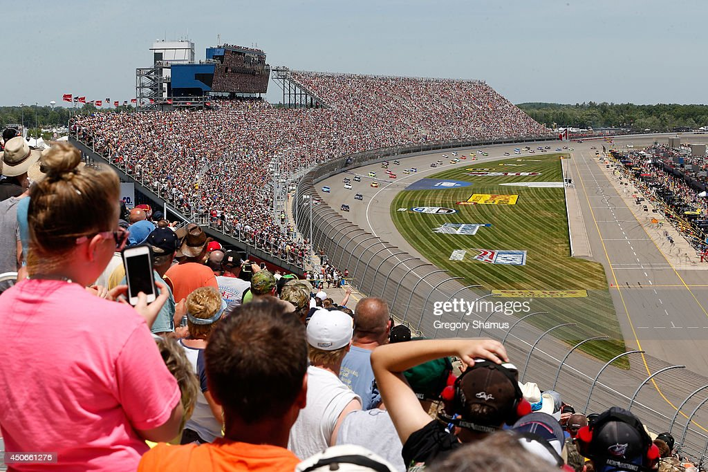 A general view of cars racing during the NASCAR Sprint Cup Series Quicken Loans 400 at Michigan International Speedway on June 15, 2014 in Brooklyn, Michigan.