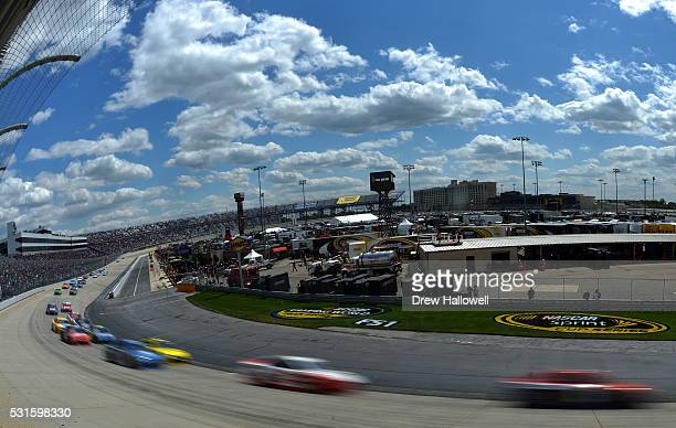 A general view of cars racing during the NASCAR Sprint Cup Series AAA 400 Drive for Autism at Dover International Speedway on May 15 2016 in Dover...