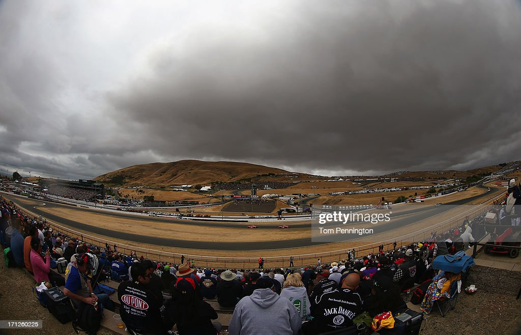A general view of cars racing during the NASCAR Sprint Cup Series Toyota/Save Mart 350 at Sonoma Raceway on June 23, 2013 in Sonoma, California.