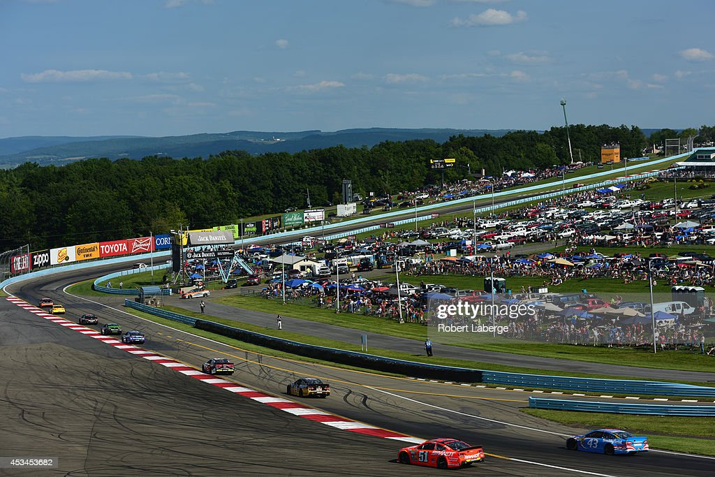A general view of cars racing the NASCAR Sprint Cup Series CheezIt 355 at Watkins Glen International on August 10 2014 in Watkins Glen New York