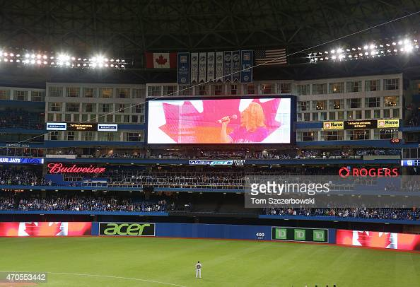A general view of center field and the jumbotron with Canadian flags displayed during the singing of the Canadian anthem before the start of the...