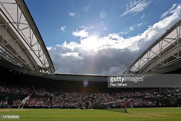 A general view of Centre Court as Andy Murray of Great Britain serves during his Gentlemen's Singles semi final match against JoWilfried Tsonga of...