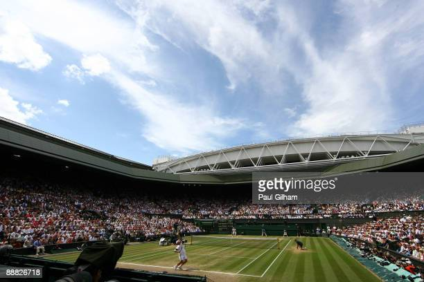 A general view of Centre Court as Andy Roddick of USA serves during the men's singles final match against Roger Federer of Switzerland on Day...