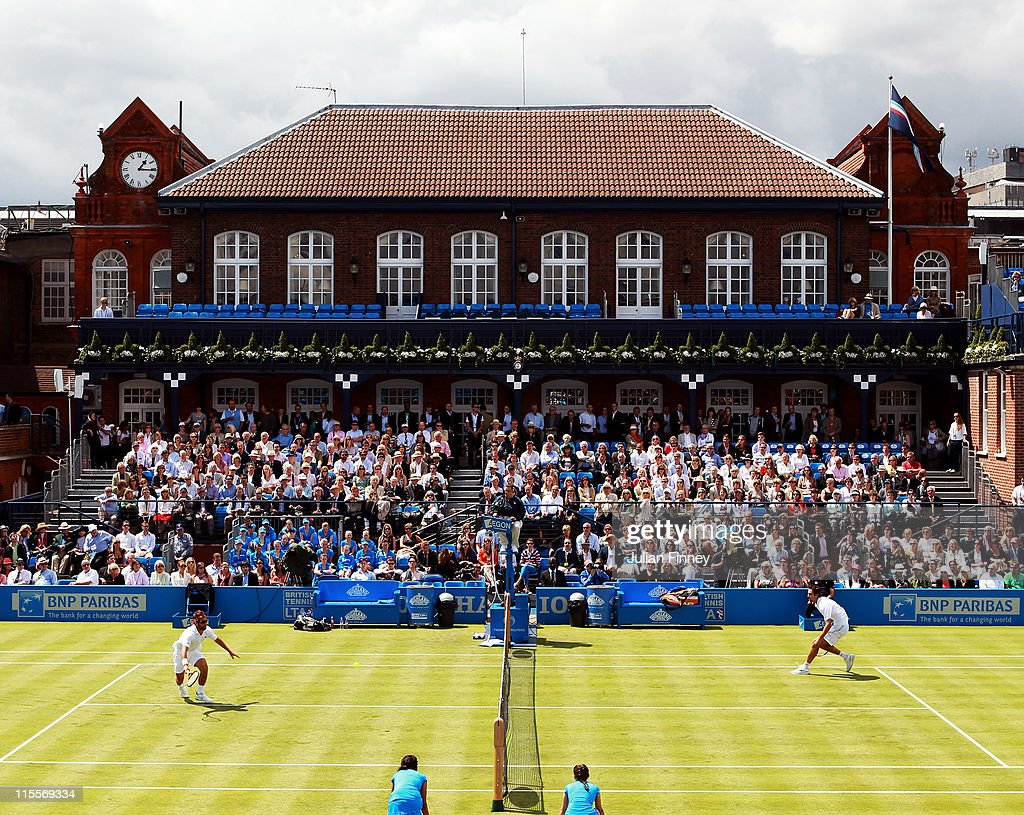 A general view of centre court as <a gi-track='captionPersonalityLinkClicked' href=/galleries/search?phrase=Arnaud+Clement&family=editorial&specificpeople=203192 ng-click='$event.stopPropagation()'>Arnaud Clement</a> of France (L) runs for the return shot during his Men's Singles second round match against <a gi-track='captionPersonalityLinkClicked' href=/galleries/search?phrase=Marin+Cilic&family=editorial&specificpeople=553788 ng-click='$event.stopPropagation()'>Marin Cilic</a> of Croatia on day three of the AEGON Championships at Queens Club on June 8, 2011 in London, England.