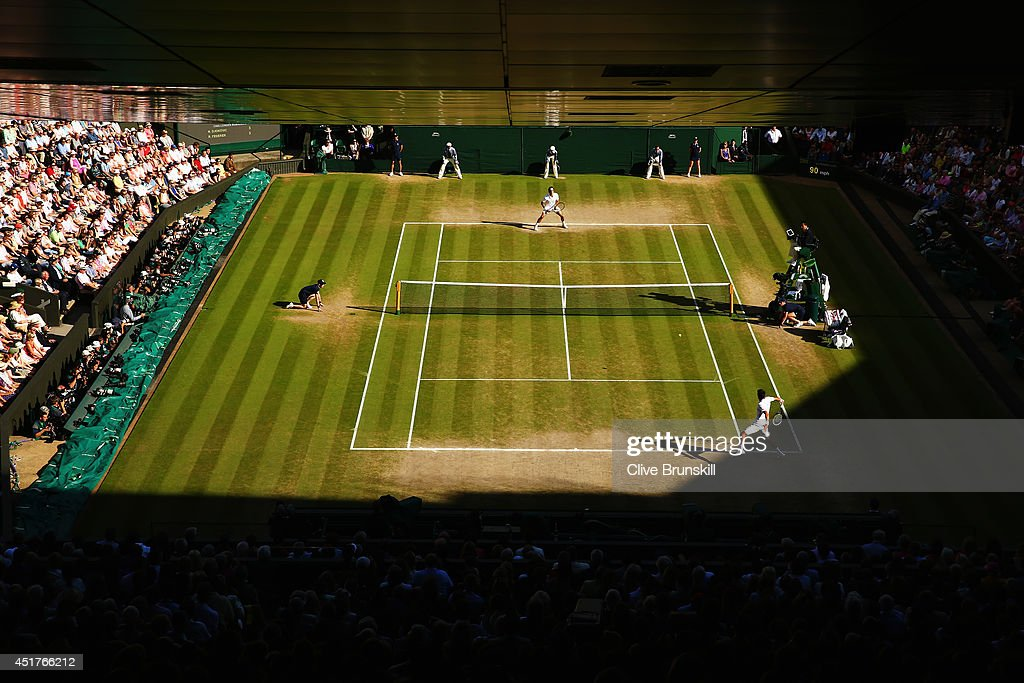 General view of centre court as Novak Djokovic of Serbia makes a return during the Gentlemen's Singles Final match against Roger Federer of...