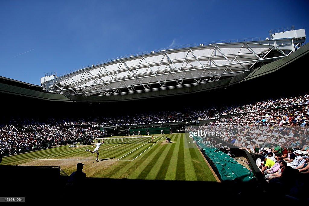 A general view of centre court as Novak Djokovic of Serbia returns during his Gentlemen's Singles semifinal match against Grigor Dimitrov of Bulgaria...