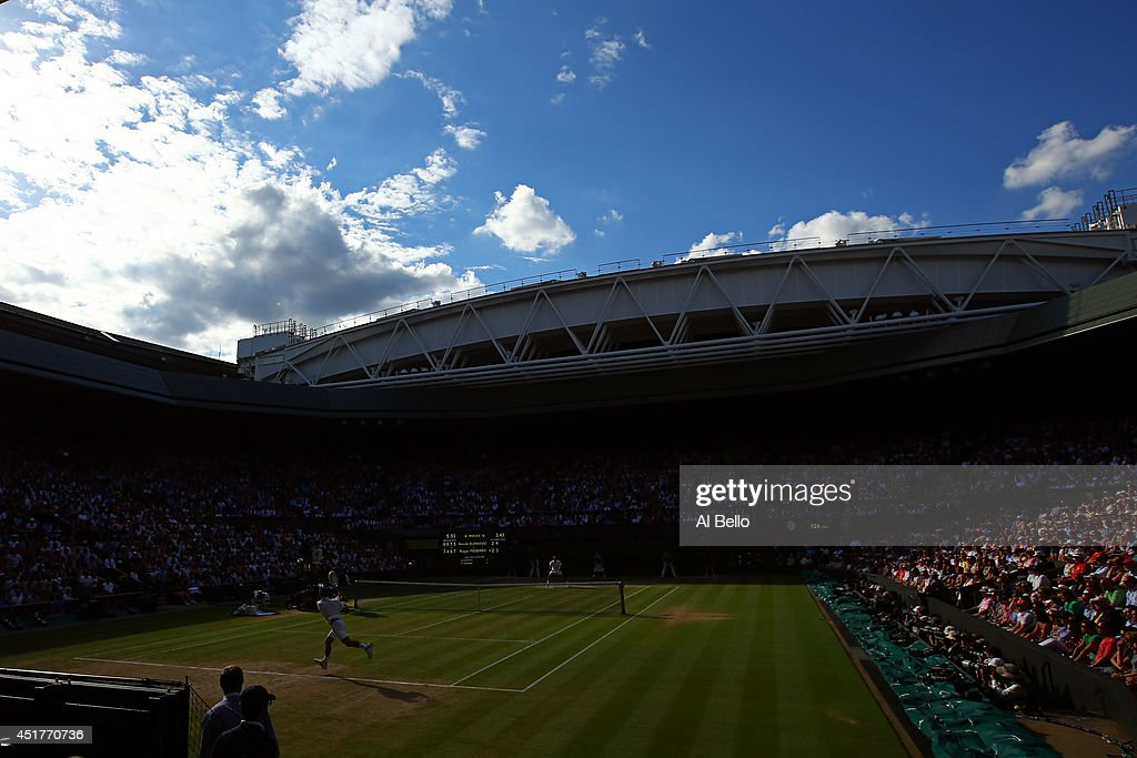 General view of centre court as Novak Djokovic of Serbia returns during the Gentlemen's Singles Final match against Roger Federer of Switzerland on...