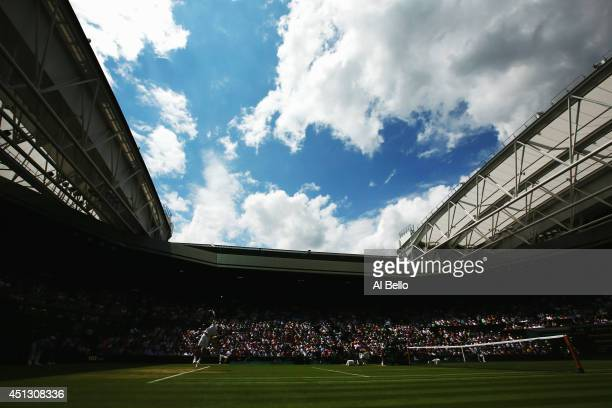 General view of Centre court as Novak Djokovic of Serbia serves during his Gentlemen's Singles third round match against Gilles Simon of France on...