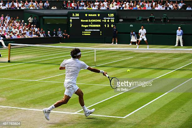 General view of centre court as Roger Federer of Switzerland makes a return during the Gentlemen's Singles Final match against Novak Djokovic of...