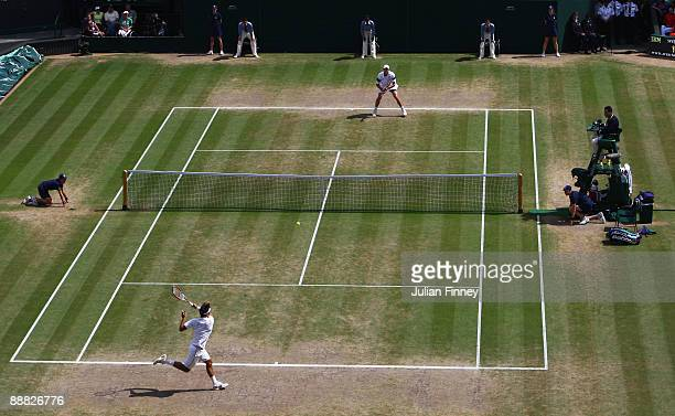 A general view of Centre Court as Roger Federer of Switzerland plays a forehand during the men's singles final match against Andy Roddick of USA on...