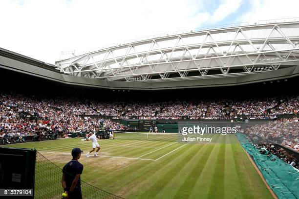 A general view of centre court as Roger Federer of Switzerland serves during the Gentlemen's Singles final against Marin Cilic of Croatia on day...