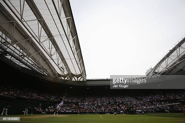 General view of centre court as Stan Wawrinka of Switzerland serves during his Gentlemen's Singles quarterfinal match against Roger Federer of...
