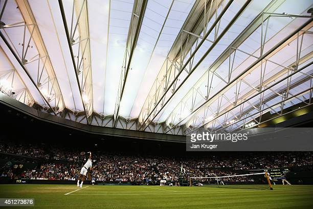 A general view of centre court with roof closed as Roger Federer of Switzerland serves during his Gentlemen's Singles second round match against...