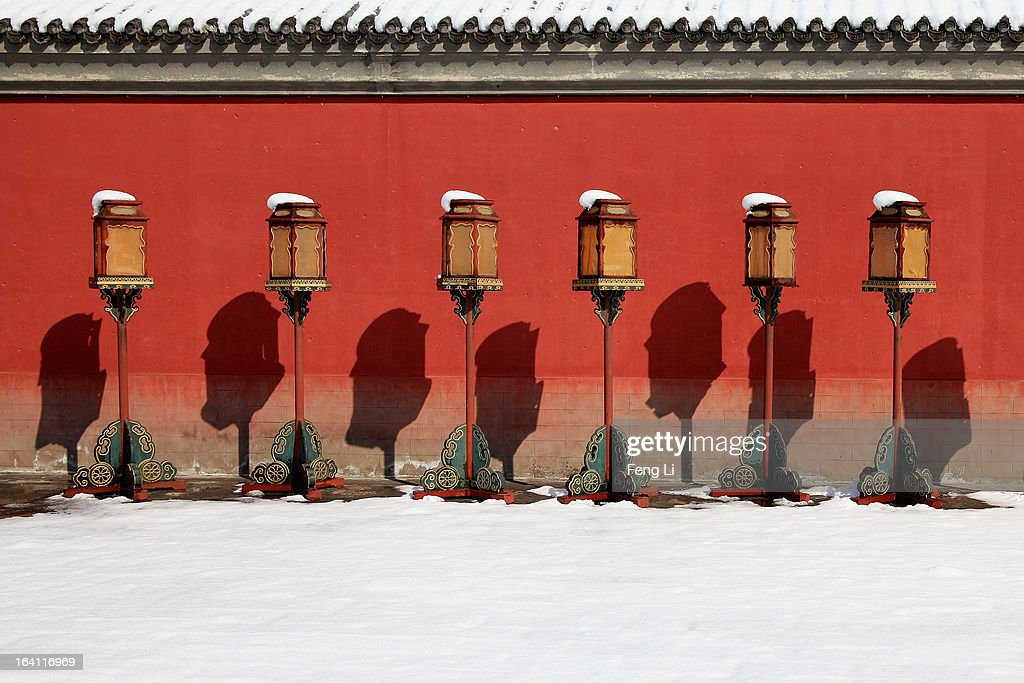 A general view of Chinese ancient floor lamps with snow at the Imperial Ancestral Temple following overnight snowfall on March 20, 2013 in Beijing, China. Beijing witnessed a heavy spring snowfall with a depth reaching 10-17 centimeters overnight.
