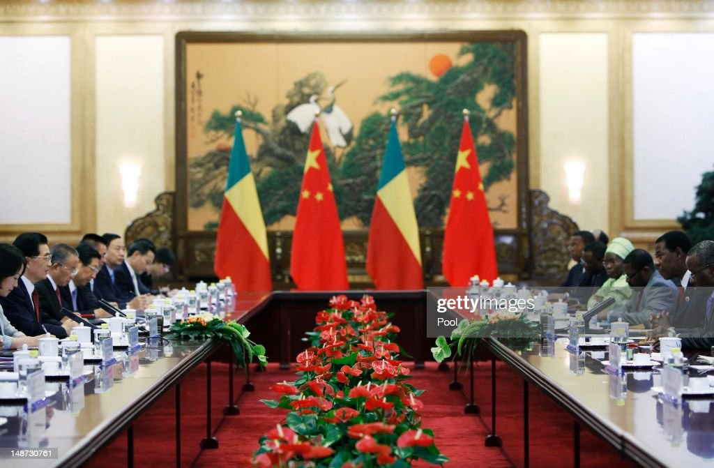 General view of Chinese President Hu Jintao (2nd L) and President of Benin <a gi-track='captionPersonalityLinkClicked' href=/galleries/search?phrase=Yayi+Boni&family=editorial&specificpeople=3974519 ng-click='$event.stopPropagation()'>Yayi Boni</a> (2nd R) in discussion during the 5th Ministerial Conference of the Forum on China-Africa Cooperation (FOCAC) held at the Great Hall of the People July 19, 2012 in Beijing, China. The conference will review cooperation between China and African nations with a view to the forming of a three year development plan focusing on accelerating socio-economic development.