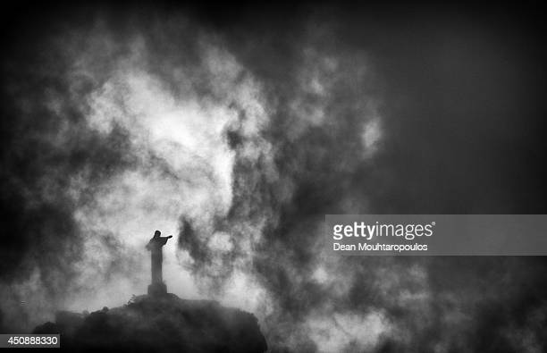 A general view of Christ the Redeemer a statue of Jesus Christ through the dark clouds during the Netherlands training session at the 2014 FIFA World...