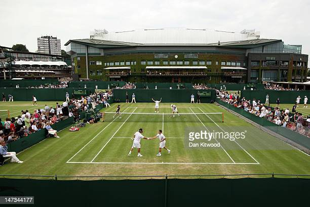 A general view of court 10 with centre court in the background during Gentlemen's Doubles first round match between Bobby Reynolds of the USA and...