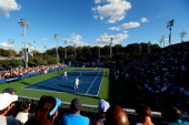 A general view of Court 11 as John McEnroe of the United States Patrick McEnroe of the United States Cedric Pioline of France and Mats Wilander of...