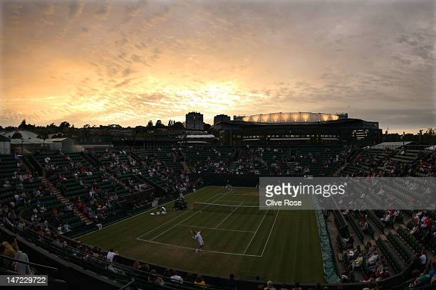 A general view of Court 2 as night falls and Richard Gasquet of France serves the ball during his Gentlemen's Singles second round match against...