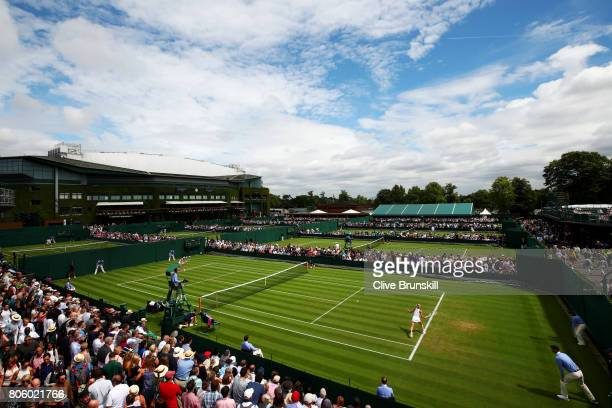 A general view of court 8 as Alize Cornet of France and Camila Giorgi of Italy compete during their Ladies Singles first round match on day one of...