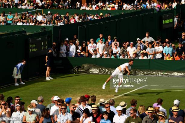 A general view of court 9 as Ryan Harrison of The United States serves during the Gentlemen's Singles first round match against Borna Coric of...