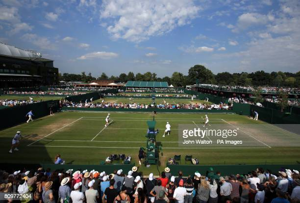 A general view of court eight as Bob and Mike Bryan take on Marcus Polmans and Andrew Whittington on day four of the Wimbledon Championships at The...