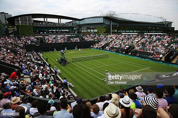 General view of court number 3 as David Ferrer of Spain plays against Pablo Carreno Busta of Spain on day one of the Wimbledon Lawn Tennis...