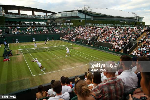 A general view of court number three during the Gentlemen's Doubles second round match between Nicolas Mahut of France and PierreHugues Herbert of...