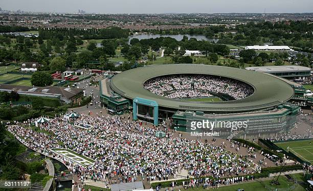 A general view of Court one and Henman Hill as Henman is in action on centre court during the first round of the Wimbledon Lawn Tennis Championship...