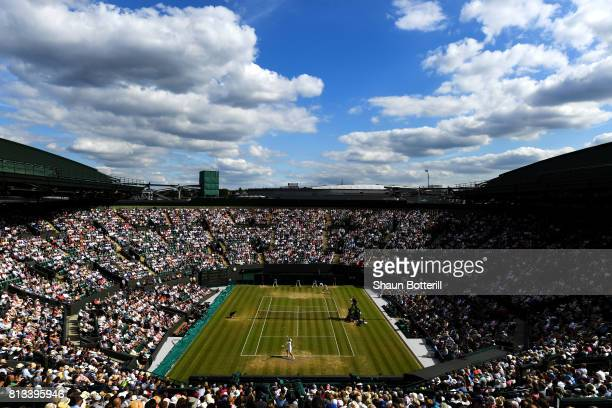 A general view of court one as Gilles Muller of Luxembourg serves during the Gentlemen's Singles quarter final match against Marin Cilic of Croatia...