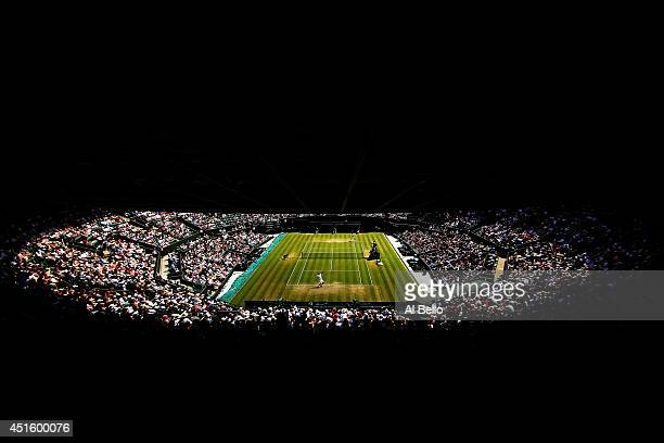A general view of court one as Marin Cilic of Croatia serves during his Gentlemen's Singles quarterfinal match against Novak Djokovic of Serbia on...