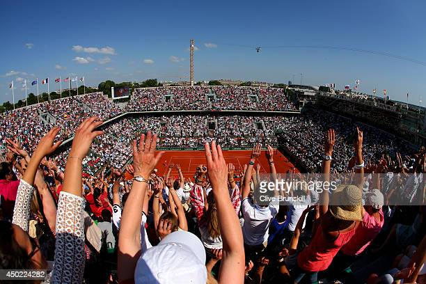 A general view of Court Philippe Chatrier as spectators take part in a mexican wave during the women's singles final match between Simona Halep of...