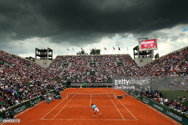 A general view of Court Suzanne Lenglen as Novak Djokovic of Serbia serves during his men's singles match against Marin Cilic of Croatia on day six...