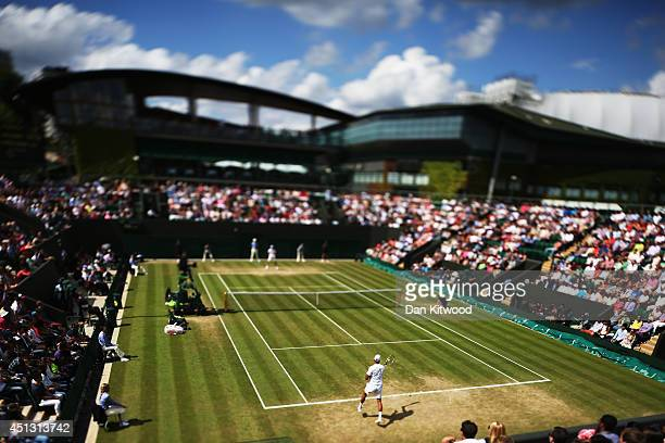 A general view of Court three as Jimmy Wang of Chinese Taipei returns to JoWilfried Tsonga of France during their Gentlemen's Singles third round...