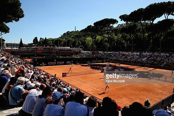 A general view of court two showing Samantha Stosur of Australia and Francesca Schiavone of Italy against Daniela Hantuchova of Slovakia and Anabel...