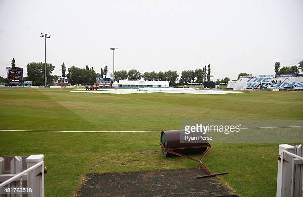 A general view of covers on the pitch after rain stopped play during day two of the Tour Match between Derbyshire and Australia at The 3aaa County...