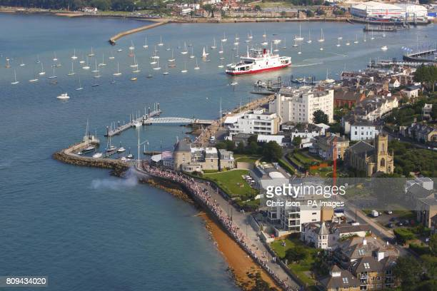 A general view of Cowes waterfront on the Isle of Wight including the Royal Yacht Squadron and the Red Funnel car ferry