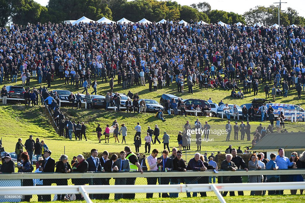 General view of crowds on the hill getting ready to watch Race 7, Grand Annual Steeplechase during Grand Annual Day at Warrnambool Race Club on May 5, 2016 in Warrnambool, Australia. The race was won by Richard Cully riding No Song No Supper for trainer Pat Payne