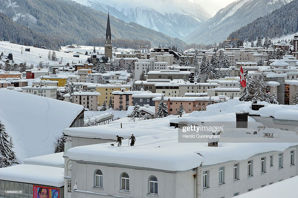 A general view of Davos and its St. John's Church is seen as Swiss army soldiers dig snow trenches on a roof on January 10, 2012 in Davos, Switzerland. The World Economic Forum, which gathers the World's top leaders, runs from January 25 - 29.