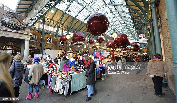 A general view of decorations shops and and shoppers in Covent Garden during the Christmas shopping period on December 11 2013 in London England
