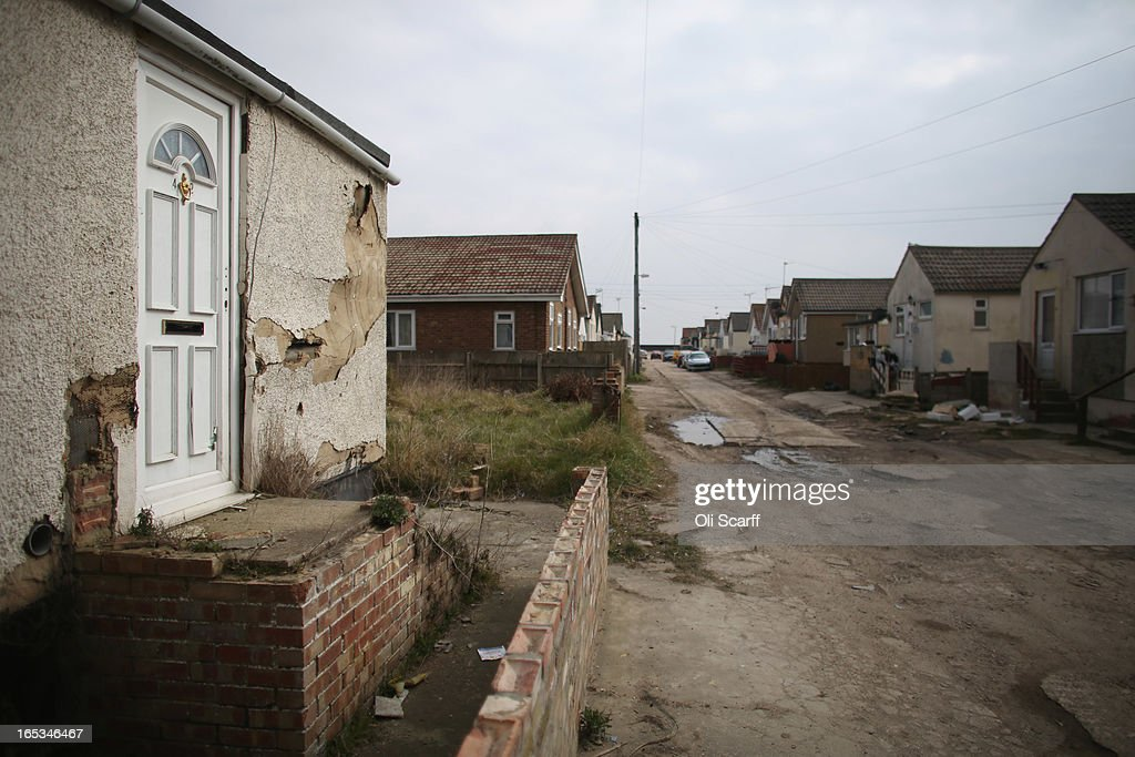 A general view of dilapidated properties in the seaside town of East Jaywick, the most deprived place in England, on April 3, 2013 in Jaywick, England. The Government's 2011 'Indices of Multiple Deprivation' measure ranks Jaywick as the most deprived of all 32,482 small wards in England and Wales. The area also has the greatest number of young people not in employment, education or training; one third of 16 to 24 year-olds claim Jobseeker's Allowance, compared to the national average of 6 per cent. Changes to the benefits and tax system which came into force on April 1, 2013 have included a cut in housing benefit payments for working-age social housing tenants whose property is deemed larger than they need and council tax support payments now being administered locally.