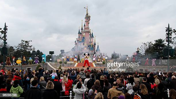 A general view of Disney characters performing during a show in the front of the Cinderella Castle during the New Generation Year Launch at...