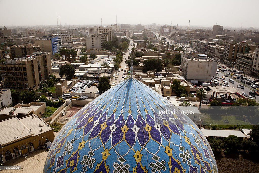 A general view of downtown Baghdad with the Dome of the 17 Ramadann Mosque in the foreground, March 18, 2013 in Baghdad, Iraq. Ten years after the regime of Saddam Hussein was toppled from power, Baghdad continues to show the scars of the war. In vast areas, infrastructure is fractured and basic services are lacking, however, some areas of the capital are showing promising signs of recovery.