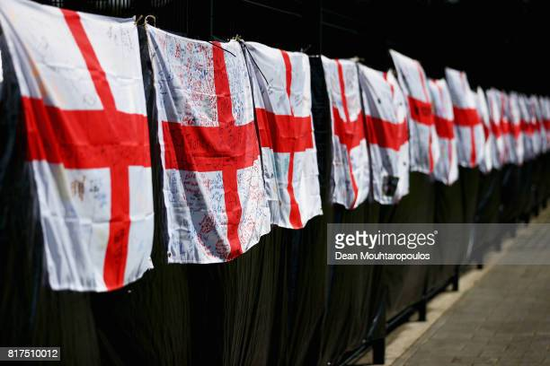 A general view of England flags covered in messages of support for the women's national team during a training session on the eve of their UEFA...