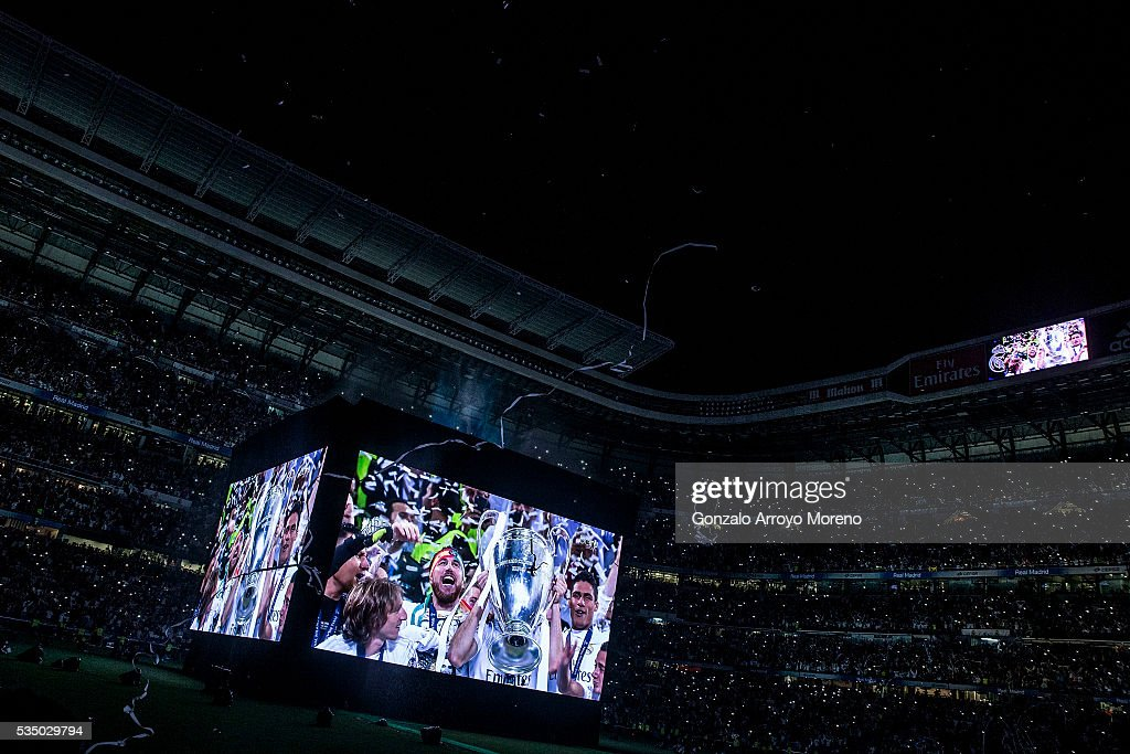 General view of Estadio Santiago Bernabeu as Sergio Ramos of Real Madrid is seen standing the Trophy on giant screens after the UEFA Champions League Final match between Real Madrid CF and Club Atletico de Madrid on May 28, 2016 in Madrid, Spain. More than 85,000 Santiago Bernabeu seats have been sold out to watch on giant screens the UEFA Champions League Final which is being held in Milan.