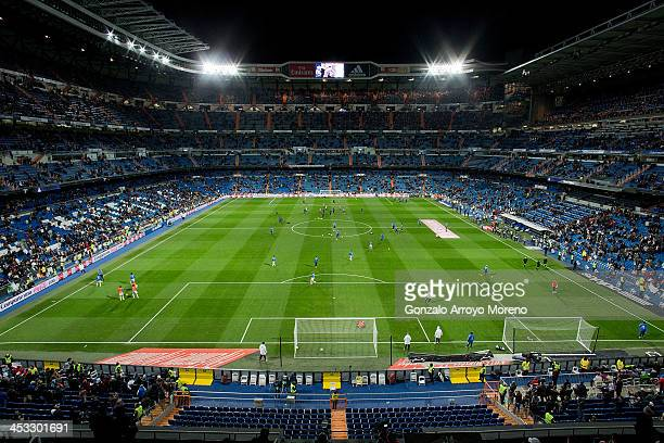 General view of Estadio Santiago Bernabeu pitch and grandstands during the team«s warming up prior to start the La Liga match between Real Madrid CF...