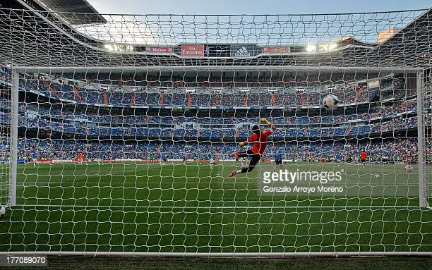 general view of Estadio Santiago Bernabeu pitch through the goal net during Real Madrid team warming up prior to start the La Liga match between Real...