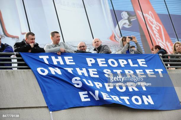 General view of Everton fans outside Wembley Stadium before kickoff with a banner that reads 'The people on the street support Everton'