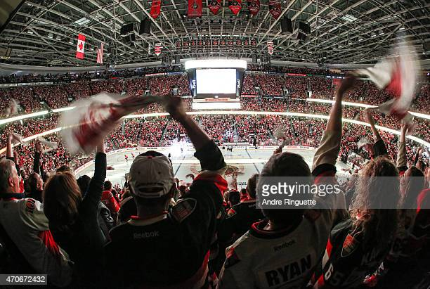 A general view of fans cheering and waving towels during player introductions prior to a game between the Ottawa Senators and the Montreal Canadiens...